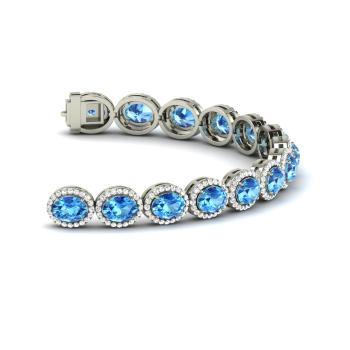 Oval Cut Blue Topaz And Diamond Tennis Bracelet In 14k White Gold